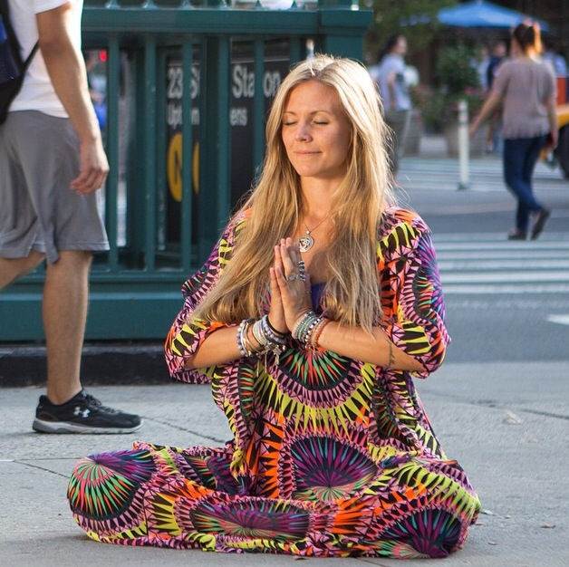 Rachel Brathen meditate on the street