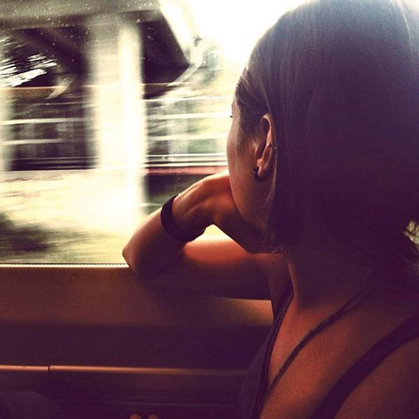 Emilee traveling by train.