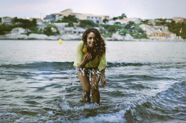 girl happy water