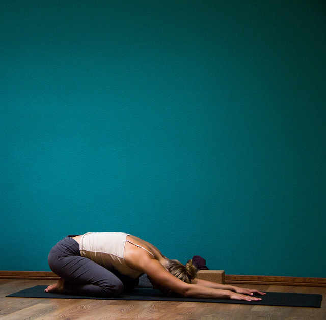 woman yoga child's pose