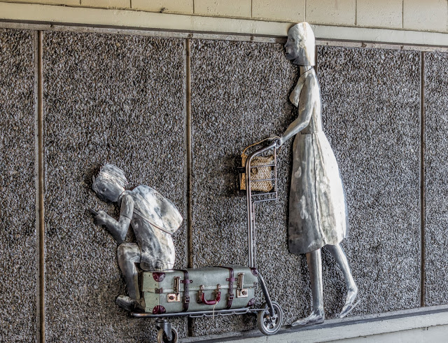 airport art mother travelling with child