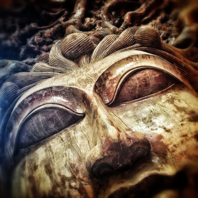 sacred object wooden goddess face