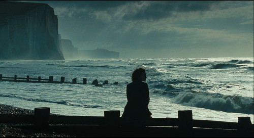 sad woman by ocean