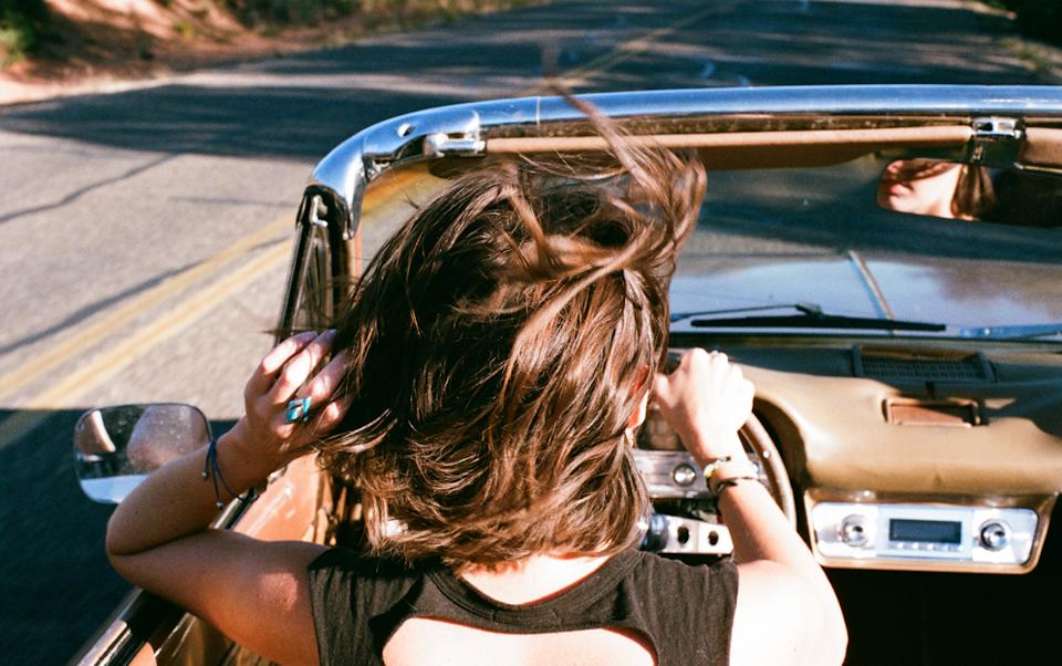 woman convertible hair blowing