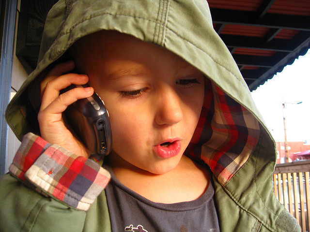 kid child on cell phone talking