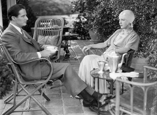 couple vintage having tea sitting
