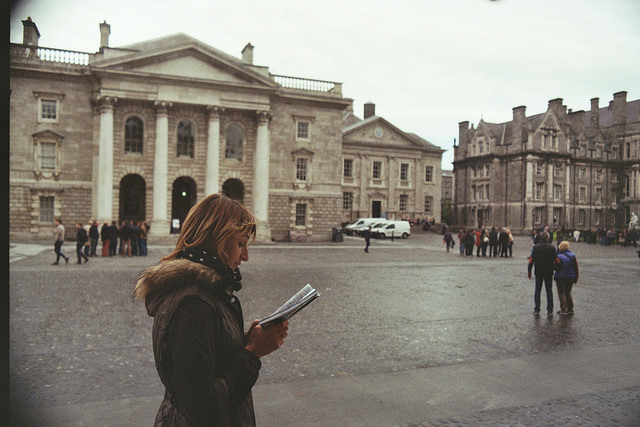 reading walking woman