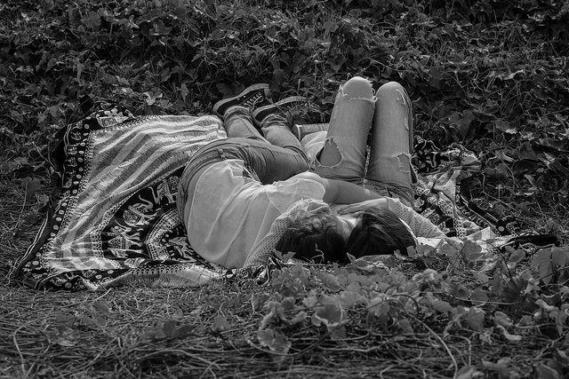 couple grass blanket
