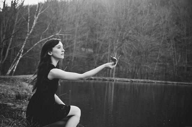 fly away woman at lake