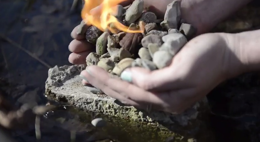 fire hands rocks