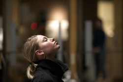 woman eyes closed meditating
