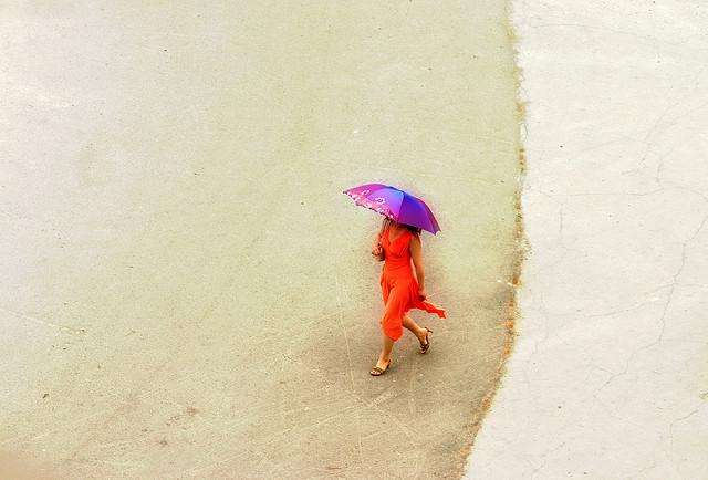 mystery woman walking umbrella