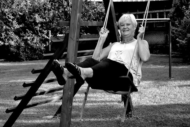 old woman on swing