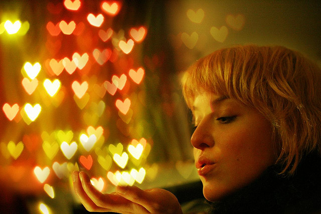 woman love hearts blowing kisses