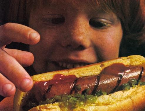 Kid eating meat