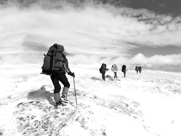 men climb mountain