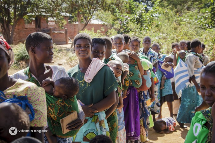 Women line up for their children's turn to receive a dose of Vitamin A