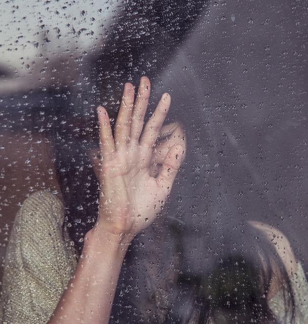 girl crying at window