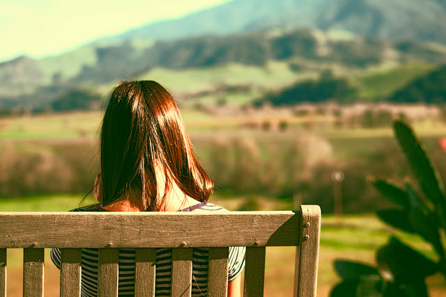 sitting thinking girl bench outside