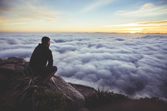 man alone sunset clouds horizon possibility