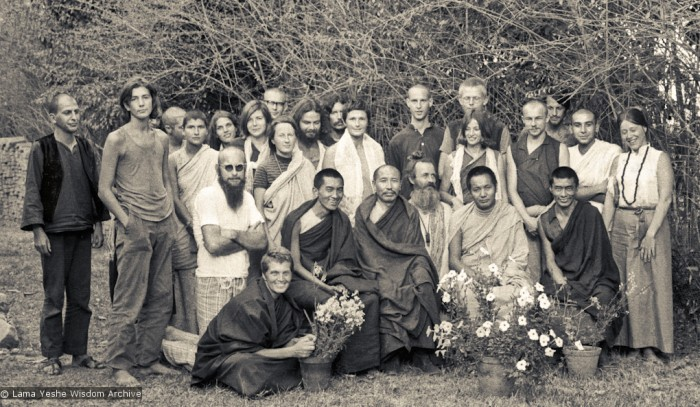 (10259_ng-Edit.psd) Group photo from the first meditation course held at Kopan Monastery, April, 1971. Left to right, front row: Zina Rachevsky, Lama Zopa Rinpoche, Geshe Thubten Tashi, Age Delbanco (Babaji), Lama Yeshe, Losang Nyima. Fred Von Allmen is at far left, Claudio Cipullo second from the end on the right, and Mark Shaneman is standing directly behind Babaji. Photo provided by Fred von Allmen.