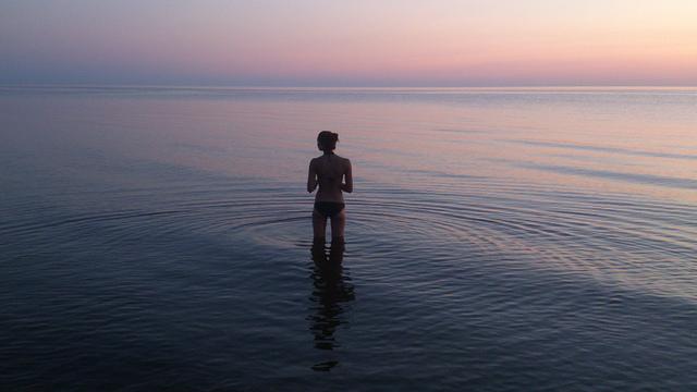 woman ocean alone