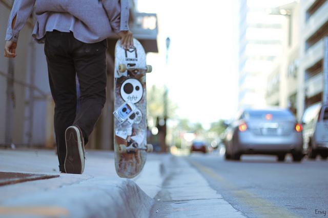 guy skater walk down street