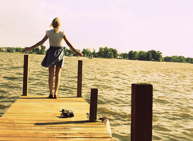 woman dock water free summer alone