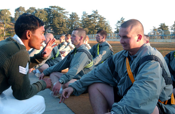 Sgt. Brian Eulo, from C Company, 3rd Battalion, 21st Infantry Regiment, are shown the correct posture for a Yoga exercise by Indian army master physical fitness instructor. C Co. is in India participating in Exercise Yudh Abhyas 07-02. (U.S. Army photo by Staff Sgt. Matthew T MacRoberts) (Released)