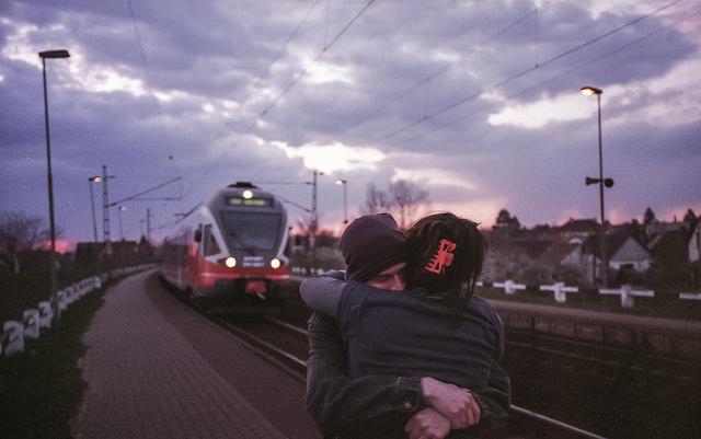 couple hug train