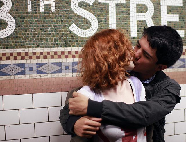 man woman couple kiss love