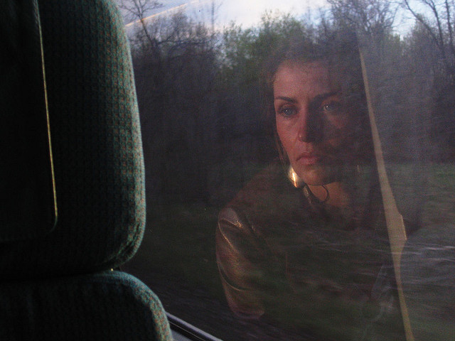 woman on train, looking out, memories