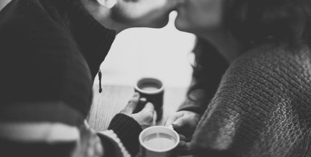 couple kiss coffee