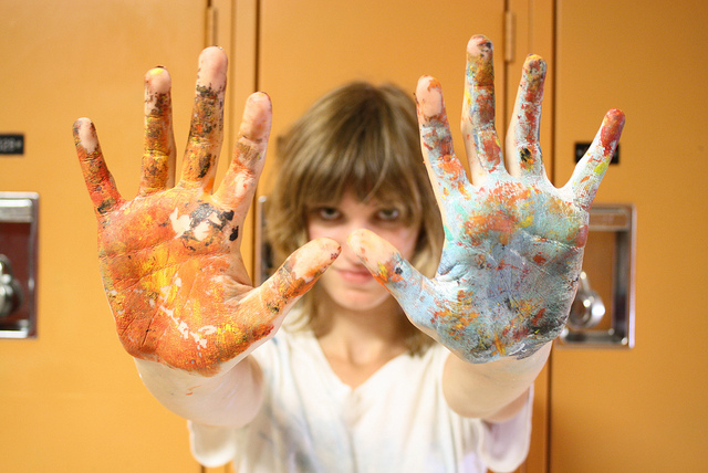 woman mess hands paint