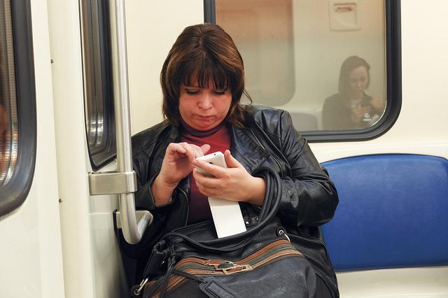 woman subway using phone