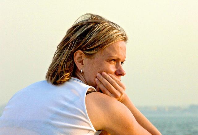 woman thinking alone sad