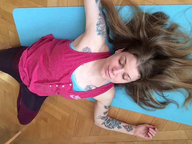yoga mat woman savasana