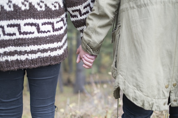 couple holding hands love cowichan sweater