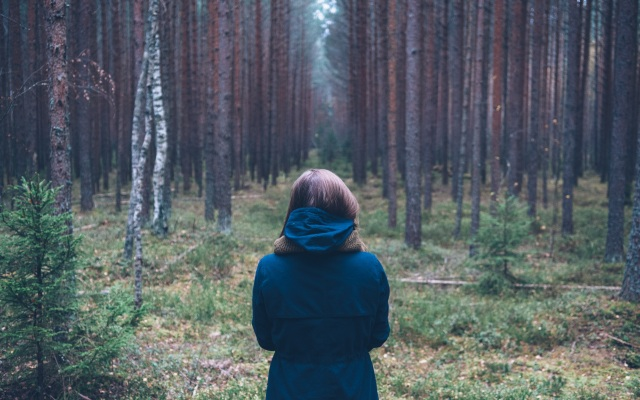 lone woman in woods