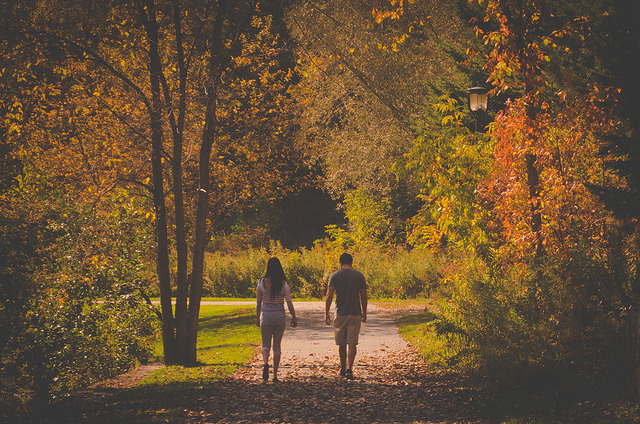 couple walking fall nature