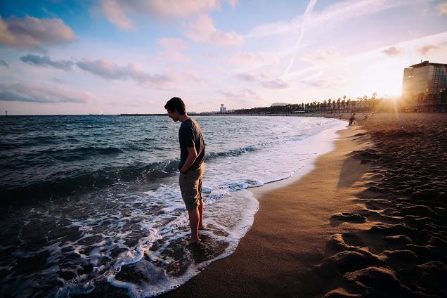 man dude by ocean water beach