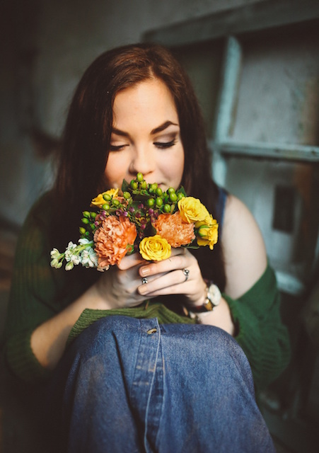 woman smelling flowers, enjoy, accepting gift