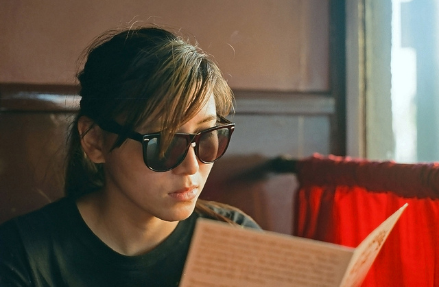 girl reading menu sunglasses restaurant dining