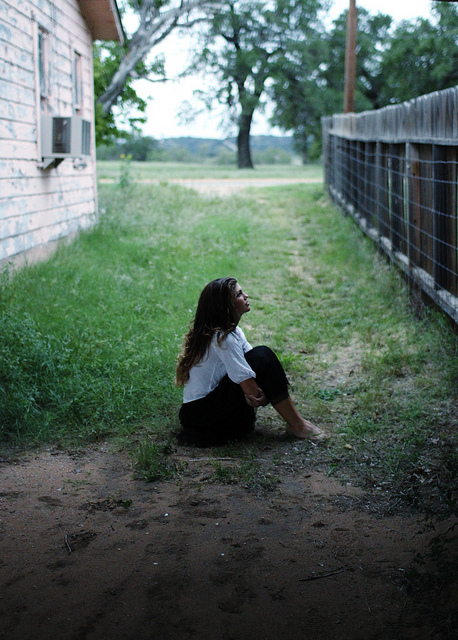 girl alone outside think sit thought sad angry