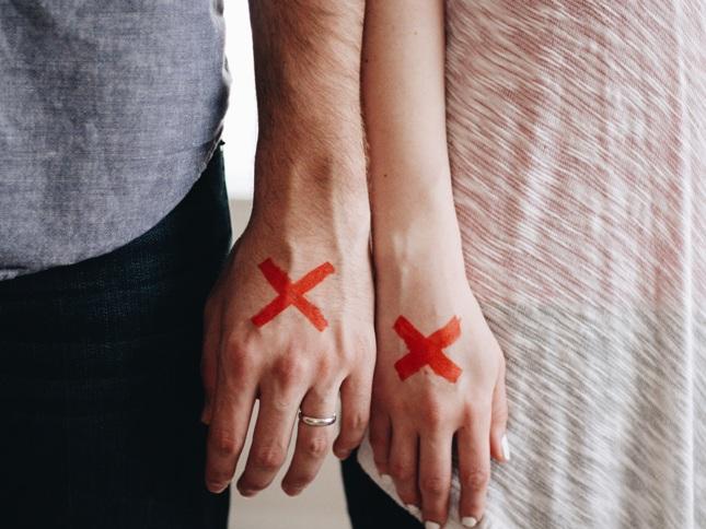red x hands couple unsplash