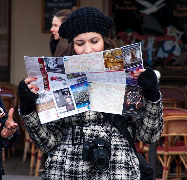 tourist woman travel lost map