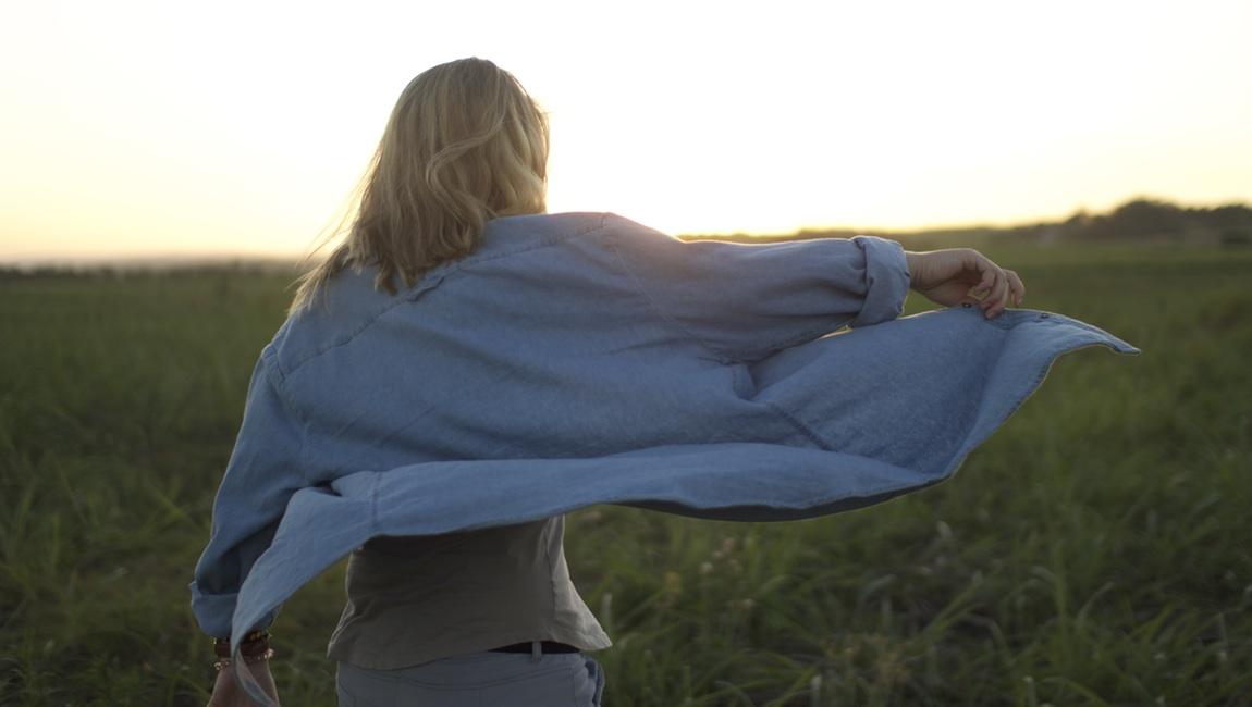 Woman, field, walking away
