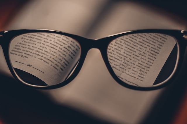 glasses perception blurry vision reading book