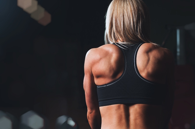 strong woman strength back muscles arms
