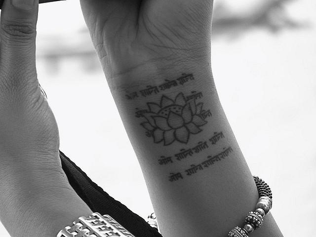 No mud no lotus why sh t needs to happen elephant journal for Tony robbins tattoo
